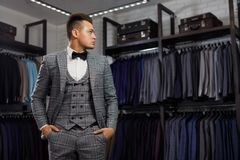 Perfect to the last detail. Modern businessman. Fashion shot of a handsome young man in elegant classic suit. Men`s. Sale, shopping, fashion, style and people Stock Image