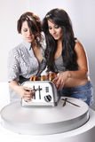 Perfect toast. Two housewifes check the quality of their toasts Royalty Free Stock Photography