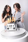 Perfect toast. Two housewifes and toasts jumping out of the toaster Royalty Free Stock Image