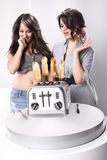 Perfect toast. Two housewifes and toasts jumping out of the toaster Royalty Free Stock Images