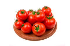 Perfect tomatoes on board for cutting Stock Photo