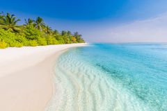 Perfect tranquil beach scene, soft sunlight and white sand and blue endless sea as tropical landscape. Vacation holidays background wallpaper, two beach lounge stock images