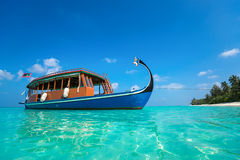 Perfect tropical island paradise beach and boat Stock Photo