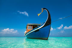 Perfect tropical island paradise beach and boat Stock Images