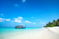 Perfect tropical island paradise beach and boat Royalty Free Stock Photo
