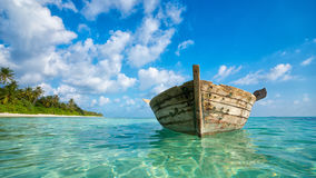 Perfect tropical island paradise beach and old boat Stock Photography