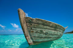 Perfect tropical island paradise beach and old boat Royalty Free Stock Photos