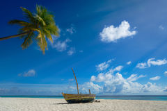 Perfect tropical island paradise beach and old boat.  Stock Photo