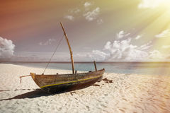 Perfect tropical island paradise beach and old boat.  Stock Image