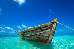 Perfect tropical island paradise beach and old boat Stock Image