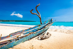 Perfect tropical island paradise beach and old boat Royalty Free Stock Images