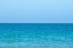 Perfect turquoise sea and blue sky in the summer. Royalty Free Stock Images