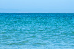 Perfect turquoise sea and blue sky in the summer. Stock Image