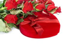 Perfect Valentines red roses with heart shaped gift box Royalty Free Stock Images