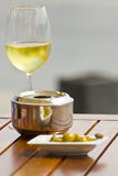 White wine, ashtray and olives Stock Photos