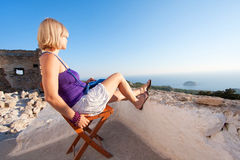 Perfect view. Young woman enjoys the view of a lanscape and sea Royalty Free Stock Images