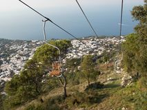 Anacapri cable car, Italy. Perfect view from the top of the mountain if you dare brave the little single seat cable car ride up with just a bar to stop you stock image