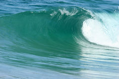 Perfect wave 2. A perfect wave rolls into the shore stock photos