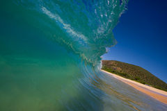 Perfect Wave Breaks on Beach Stock Photography
