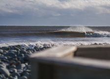 Perfect wave on a cloudy day. A perfect wave on a cloudy day Royalty Free Stock Image