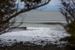 Perfect wave on a cloudy day. A perfect wave on a cloudy day Royalty Free Stock Photography