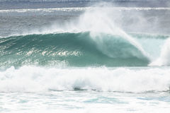 Perfect Wave. A wave goes unridden at Kirra on the Gold Coast Australia Royalty Free Stock Photography