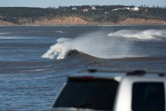 Perfect wave on a sunny day. A perfect wave on a sunny day Stock Photos