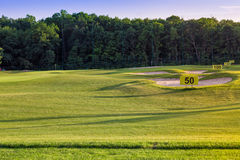 Perfect wavy ground with green grass on a golf field Stock Image