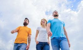 Perfect wear to set the mood right. Fashion people look casual in summer outfit. Group of people in casual wear. Young. People in casual style on cloudy sky royalty free stock images