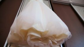 The perfect wedding dress in the room of the bride. stock footage