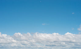 Perfect white fluffy clouds sky Stock Photography