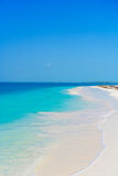Perfect white sandy beach with turquoise water and blue sky. Amazing picture Royalty Free Stock Images