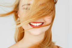 Perfect white smile of red-haired girl, close-up. Widely smiling happy carroty woman portrait. Good dentist, teeth care, whitening concept Stock Photography