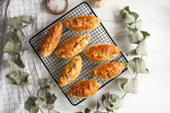 Small baked pies with filling and sesame seeds. Perfect for whole family breakfast: small baked pies with filling and sesame seeds stock photography