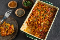 Homemade dish with simple and tasty ingredients from farm. The perfect winter comfort food with rich flavours made from corn, cheese and bacon stock photo