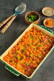Homemade dish with simple and tasty ingredients from farm. The perfect winter comfort food with rich flavours made from corn, cheese and bacon stock photography