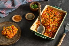 Homemade dish with simple and tasty ingredients from farm. The perfect winter comfort food with rich flavours made from corn, cheese and bacon royalty free stock images