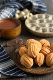 """Russian walnut shaped cookies with caramely filling – """"Oreshki"""". The perfect winter homemade traditional russian festive cookies stock images"""