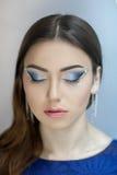 Perfect woman blue makeup Stock Photos