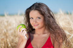 Perfect woman eating apple Stock Photos