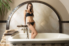 Perfect woman in elegant bathtub Royalty Free Stock Image