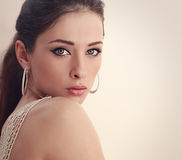 Perfect woman face looking with mystery green eyes. Closeup Royalty Free Stock Image