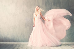 Perfect Woman Fashion Model in Pink Evening Gown. And Flowers Wreath Stock Photography