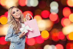 Perfect woman with gifts on sparkle background stock photography