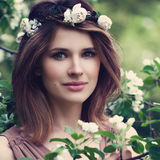 Perfect Woman with Healthy Skin and Hair. Natural Beauty. Perfect Woman with Healthy Skin and Hair with Flowers Royalty Free Stock Image