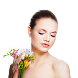 Perfect Woman with Healthy Skin. Spa Model. With Flowers Royalty Free Stock Photos