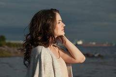 Perfect woman looking at skyline outdoors. Beautiful girl romantic portrait royalty free stock image