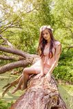 Perfect woman model with white flowers in her hair in spring park outdoors. Romantic girl outdoor portrait royalty free stock photography