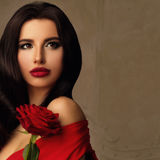 Perfect Woman with Red Rose Flower. Beautiful Model with Makeup and Hairstyle on Vintage Background with Copyspace Royalty Free Stock Photos