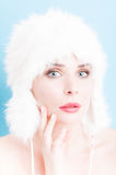 Perfect woman skin wearing daytime makeup and fur hat Stock Images